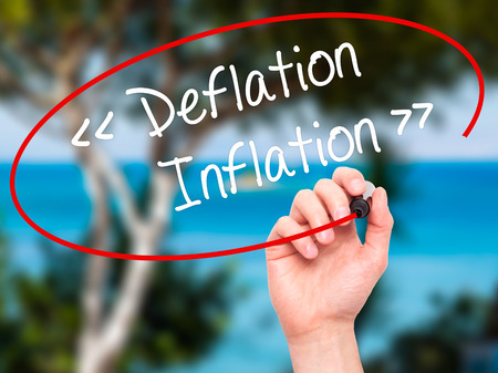 deflation: Man Hand writing Deflation - Inflation with black marker on visual screen. Isolated on background. Business, technology, internet concept. Stock Photo