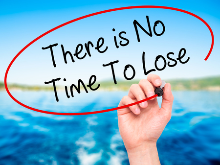 no time: Man Hand writing There is No Time To Lose with black marker on visual screen. Isolated on background. Business, technology, internet concept. Stock Photo