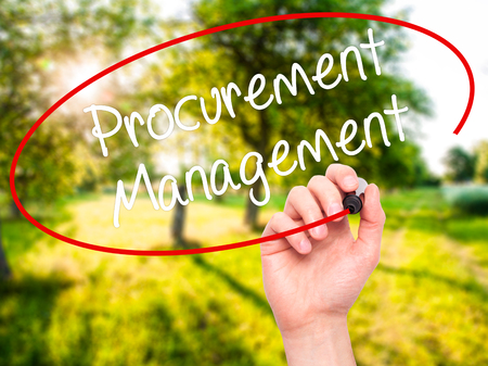procure: Man Hand writing Procurement Management with black marker on visual screen. Isolated on background. Business, technology, internet concept. Stock Photo