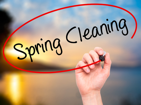 scour: Man Hand writing Spring Cleaning with black marker on visual screen. Isolated on background. Business, technology, internet concept. Stock Photo