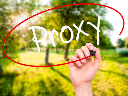 proxy: Man Hand writing Proxy with black marker on visual screen. Isolated on background. Business, technology, internet concept. Stock Photo Stock Photo