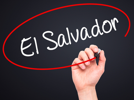 el salvadoran: Man Hand writing El Salvador with black marker on visual screen. Isolated on background. Business, technology, internet concept. Stock Photo Stock Photo