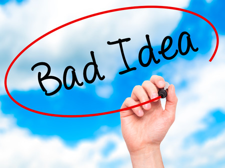 junky: Man Hand writing Bad Idea with black marker on visual screen. Isolated on background. Business, technology, internet concept. Stock Photo
