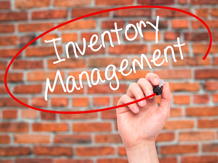 stockroom: Man Hand writing Inventory Management with black marker on visual screen. Isolated on background. Business, technology, internet concept. Stock Photo