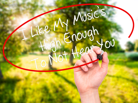 unloved: Man Hand writing I Like My Musics High Enough To Not Hear You with black marker on visual screen. Isolated on background. Business, technology, internet concept. Stock Photo