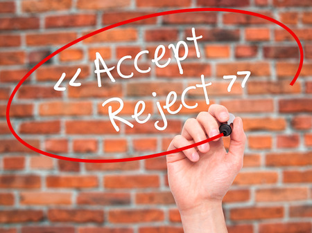 verifying: Man Hand writing Accept - Reject  with black marker on visual screen. Isolated on background. Business, technology, internet concept. Stock Photo Stock Photo