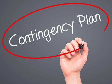 contingency: Man Hand writing Contingency Plan with black marker on visual screen. Isolated on background. Business, technology, internet concept. Stock Photo Stock Photo
