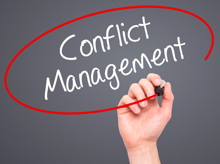 resolution: Man Hand writing Conflict Management with black marker on visual screen. Isolated on background. Business, technology, internet concept. Stock Photo