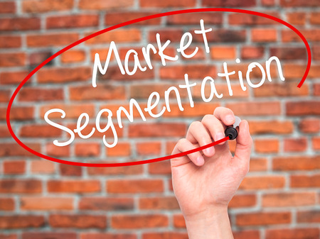 categorize: Man Hand writing Market Segmentation with black marker on visual screen. Isolated on background. Business, technology, internet concept. Stock Photo