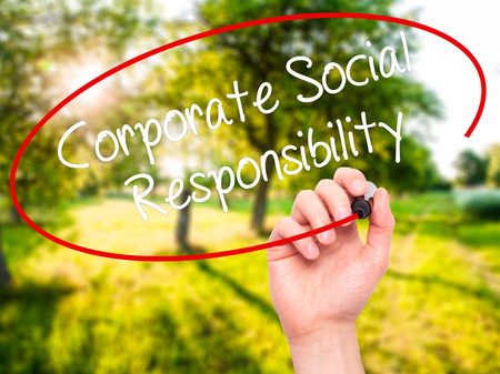 Man Hand writing Corporate Social Responsibility with black marker on visual screen. Isolated on background. Business, technology, internet concept. Stock Photo Standard-Bild