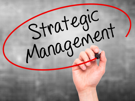 formulation: Man Hand writing Strategic Management with black marker on visual screen. Isolated on background. Business, technology, internet concept. Stock Photo Stock Photo