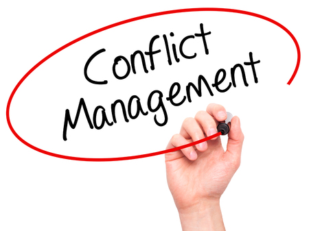 oppose: Man Hand writing Conflict Management with black marker on visual screen. Isolated on background. Business, technology, internet concept. Stock Photo