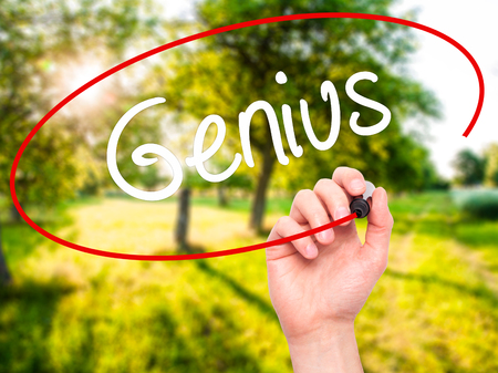 savant: Man Hand writing Genius  with black marker on visual screen. Isolated on background. Business, technology, internet concept. Stock Photo