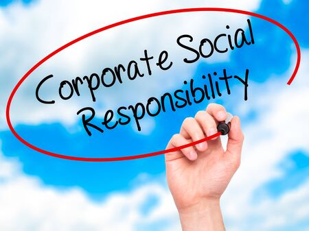 business roles: Man Hand writing Corporate Social Responsibility with black marker on visual screen. Isolated on background. Business, technology, internet concept. Stock Photo Stock Photo