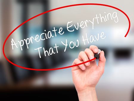 personal god: Man Hand writing Appreciate Everything That You Have with black marker on visual screen. Isolated on background. Business, technology, internet concept. Stock Photo