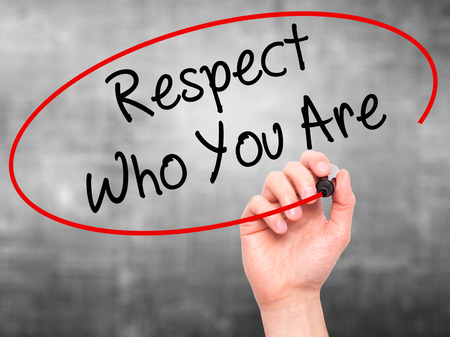 respect: Man Hand writing Respect Who You Are with black marker on visual screen. Isolated on background. Business, technology, internet concept. Stock Photo