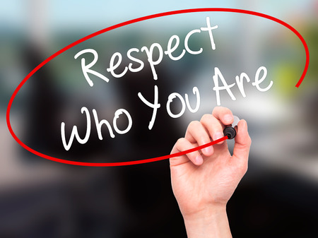 revere: Man Hand writing Respect Who You Are with black marker on visual screen. Isolated on background. Business, technology, internet concept. Stock Photo