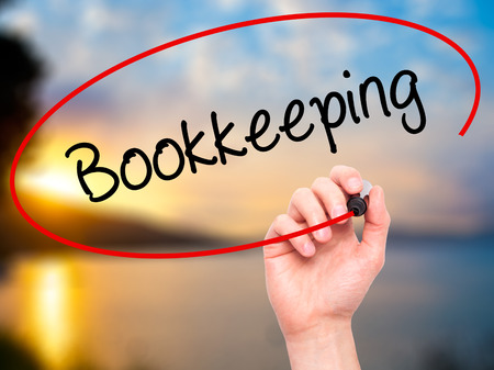 double click: Man Hand writing Bookkeeping with black marker on visual screen. Isolated on background. Business, technology, internet concept. Stock Photo