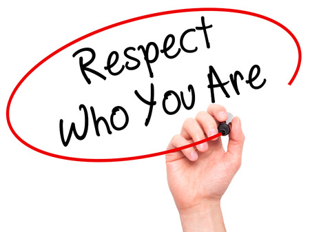 Man Hand writing Respect Who You Are with black marker on visual screen. Isolated on background. Business, technology, internet concept. Stock Photo