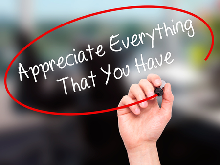 Man Hand writing Appreciate Everything That You Have with black marker on visual screen. Isolated on background. Business, technology, internet concept. Stock Photo