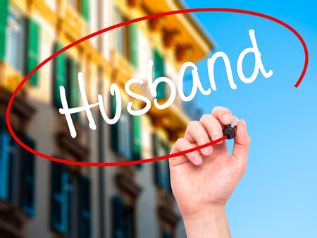 ex husband: Man Hand writing Husband with black marker on visual screen. Isolated on background. Business, technology, internet concept. Stock Photo