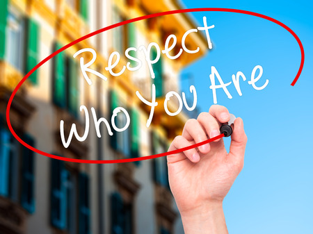 courteous: Man Hand writing Respect Who You Are with black marker on visual screen. Isolated on background. Business, technology, internet concept. Stock Photo