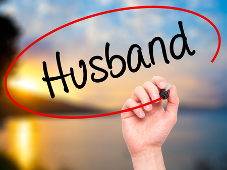 ex wife: Man Hand writing Husband with black marker on visual screen. Isolated on background. Business, technology, internet concept. Stock Photo