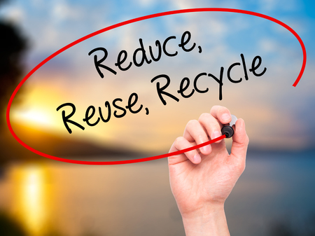 reduce reuse recycle: Man Hand writing Reduce Reuse Recycle with black marker on visual screen. Isolated on background. Business, technology, internet concept. Stock Photo