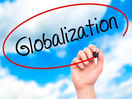 exportation: Man Hand writing Globalization with black marker on visual screen. Isolated on background. Business, technology, internet concept. Stock Photo