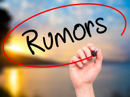 blab: Man Hand writing Rumors  with black marker on visual screen. Isolated on background. Business, technology, internet concept. Stock Photo Stock Photo