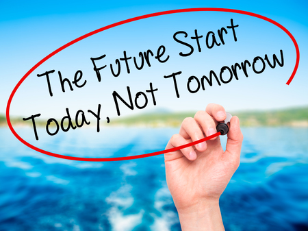 necessity: Man Hand writing The Future Start Today, Not Tomorrow with black marker on visual screen. Isolated on background. Business, technology, internet concept. Stock Photo Stock Photo