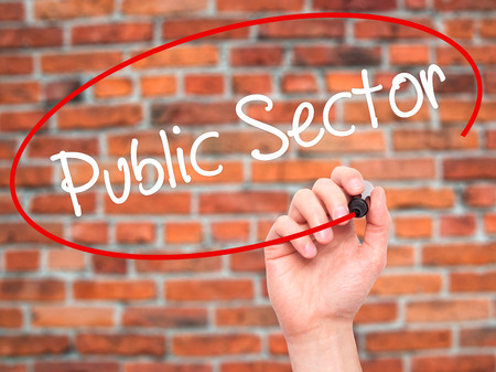 Man Hand writing Public Sector with white marker on visual screen. Isolated on background. Business, technology, internet concept. Stock Photo Imagens