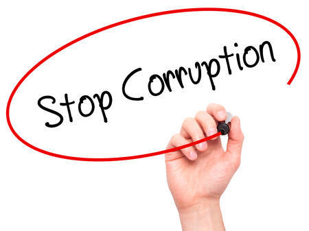misconduct: Man Hand writing Stop Corruption with black marker on visual screen. Isolated on background. Business, technology, internet concept. Stock Photo