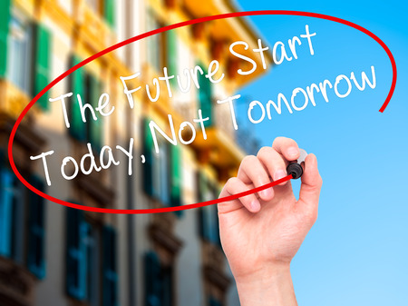 necessity: Man Hand writing The Future Start Today, Not Tomorrow with white marker on visual screen. Isolated on background. Business, technology, internet concept. Stock Photo Stock Photo