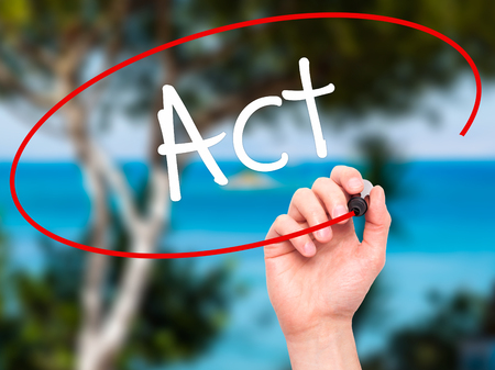 react: Man Hand writing Act with white marker on visual screen. Isolated on background. Stock Photo
