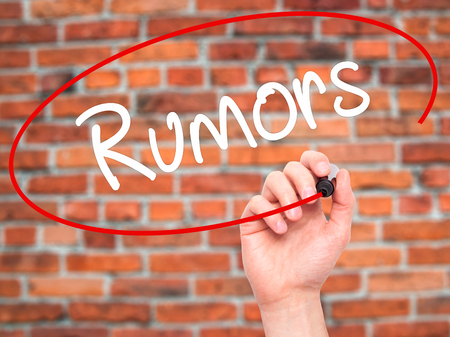 rumors: Man Hand writing Rumors  with white marker on visual screen. Isolated on background.