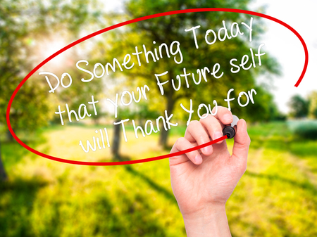 Man Hand writing Do Something Today that your Future self will Thank You for with white marker on visual screen. Isolated on background. Stock fotó