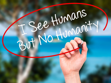humanity: Man Hand writing I See Humans But No Humanity with black marker on visual screen. Isolated on background. Business, technology, internet concept. Stock  Photo Stock Photo