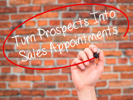 the prospects: Man Hand writing Turn Prospects Into Sales Appointments with black marker on visual screen. Isolated on background. Business, technology, internet concept. Stock  Photo