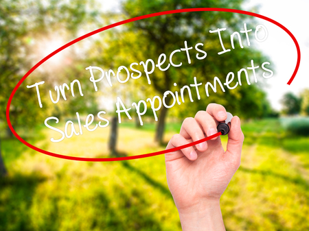 appointments: Man Hand writing Turn Prospects Into Sales Appointments with black marker on visual screen. Isolated on background. Business, technology, internet concept. Stock  Photo