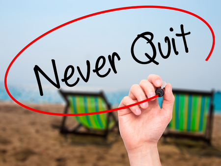 persist: Man Hand writing Never Quit with black marker on visual screen. Isolated on background. Business, technology, internet concept. Stock  Photo Stock Photo
