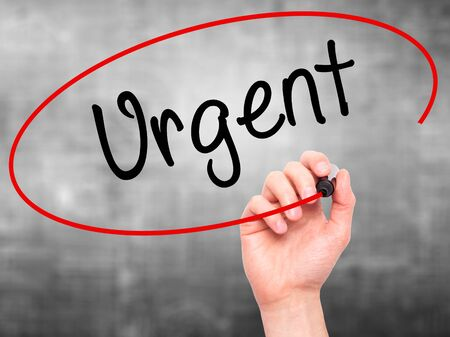 persuasive: Man Hand writing Urgent  with black marker on visual screen. Isolated on background. Business, technology, internet concept. Stock  Photo Stock Photo