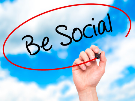 recruit help: Man Hand writing Be Social with black marker on visual screen. Isolated on background. Business, technology, internet concept. Stock  Photo