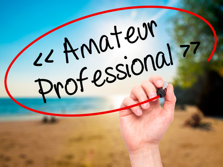 amateur: Man Hand writing Amateur - Professional with black marker on visual screen. Isolated on background. Business, technology, internet concept. Stock  Photo Foto de archivo