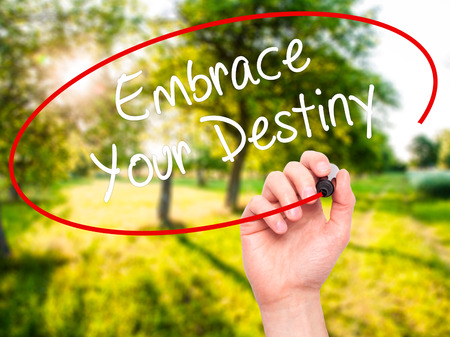 Man Hand writing Embrace Your Destiny with black marker on visual screen. Isolated on background. Business, technology, internet concept. Stock  Photo