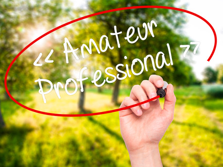 AFICIONADOS: Man Hand writing Amateur - Professional with black marker on visual screen. Isolated on background. Business, technology, internet concept. Stock  Photo Foto de archivo