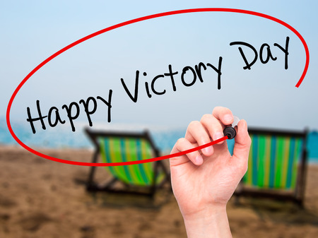 light duty: Man Hand writing Happy Victory Day with black marker on visual screen. Isolated on background. Business, technology, internet concept. Stock  Photo Stock Photo