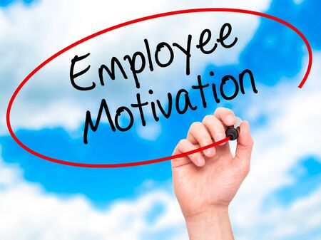 govern: Man Hand writing Employee Motivation with black marker on visual screen. Isolated on background. Business, technology, internet concept. Stock  Photo Stock Photo