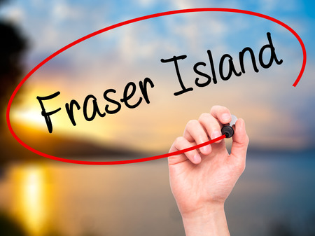 fraser: Man Hand writing Fraser Island with black marker on visual screen. Isolated on background. Business, technology, internet concept. Stock  Photo