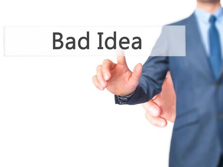 bad idea: Bad Idea - Businessman hand pressing button on touch screen interface. Business, technology, internet concept. Stock Photo Stock Photo
